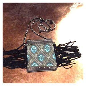Aztec print fringe bag